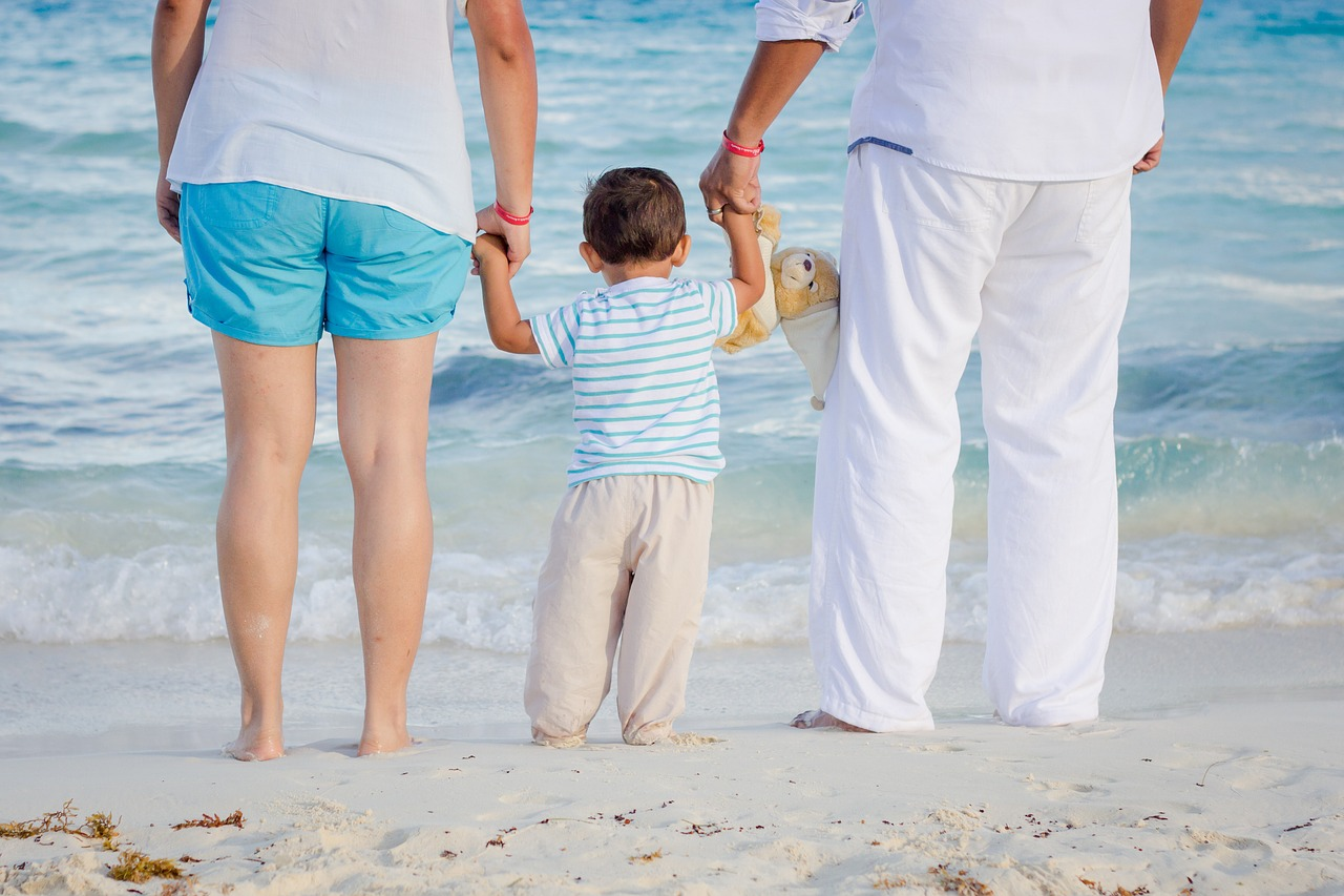 Child With Their Family on the Beach